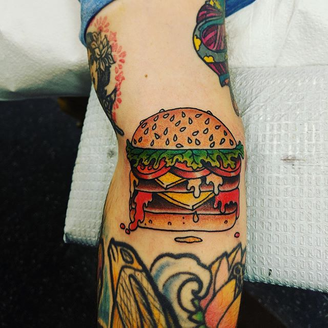 Shout to the homie @vidhyan for creating my cheeseburger, thanks to @marshallgarfieldbrown for making it indelible. #cheeseburgertattoo #justisjustwas
