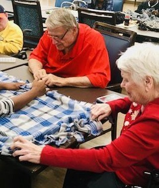 Guests at our Shelby location making sew blankets to donate to a local charity. #CommunityEngagement #GiveBack