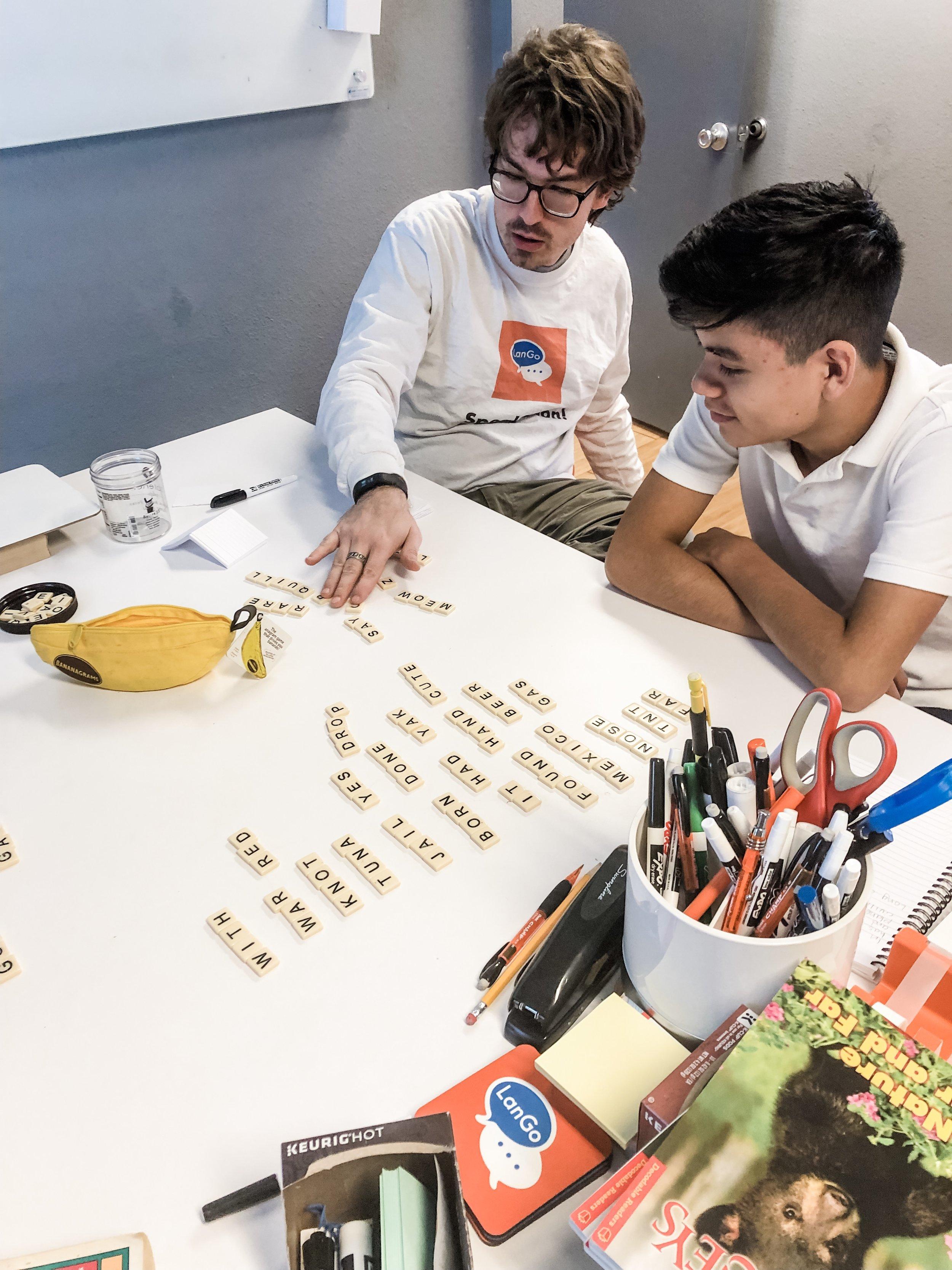 Iñigo playing a vocab review game with Levi, LanGo intern.