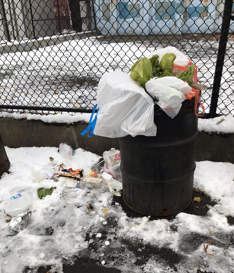 overflowing trash barrels not being emptied