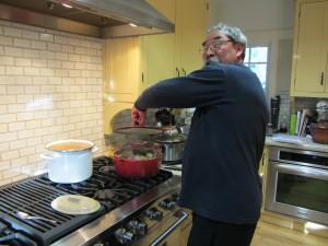 Pablo making tamale stuffing