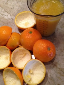 Orange halves and juice