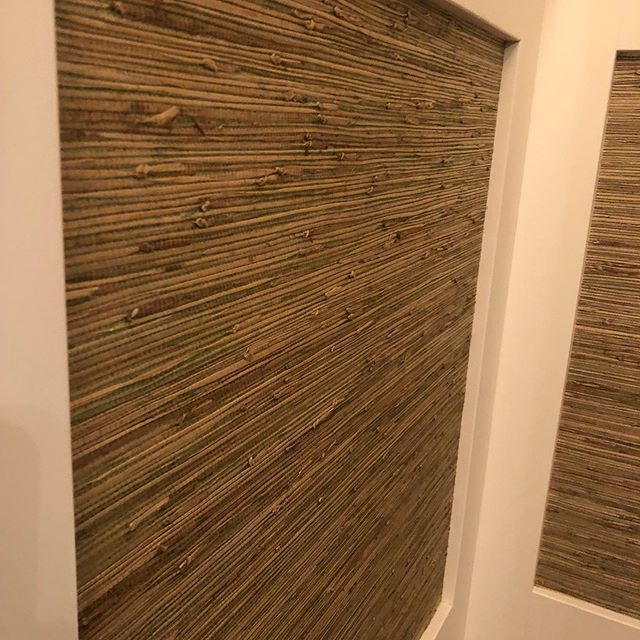 Who doesn't love a beautiful Grass Cloth....this powder room has millwork and we left open panels to feature this beautiful wallpaper and it's stunning!