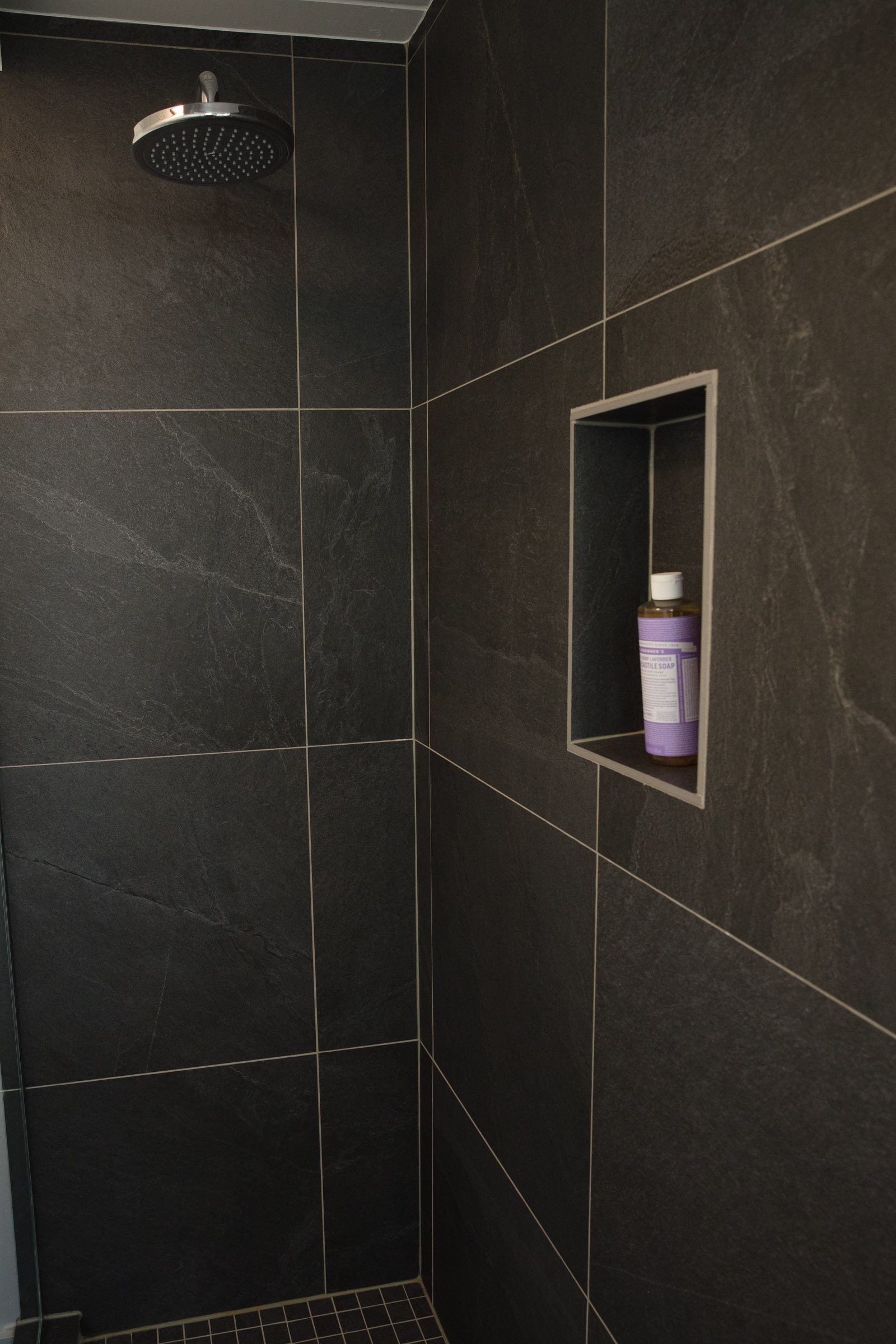 The main bathroom as a walk-in glass shower and in-floor radiant heat.