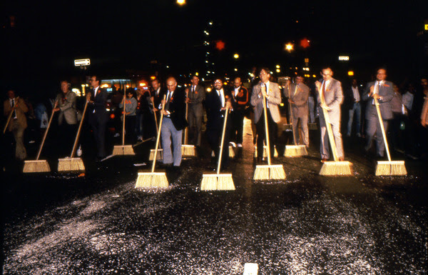 Image: theartblog.org. Mierle Laderman Ukeles,  Sanitation Celebrations Grand Finale of the First NYC Art Parade, Part III: Ceremonial Sweep,  1983. Sanitation and union executives and municipal, arts, and cultural leaders clean the entire parade route along with the artist and her family. Courtesy of Ronald Feldman Fine Arts. Photo: Paula Court.