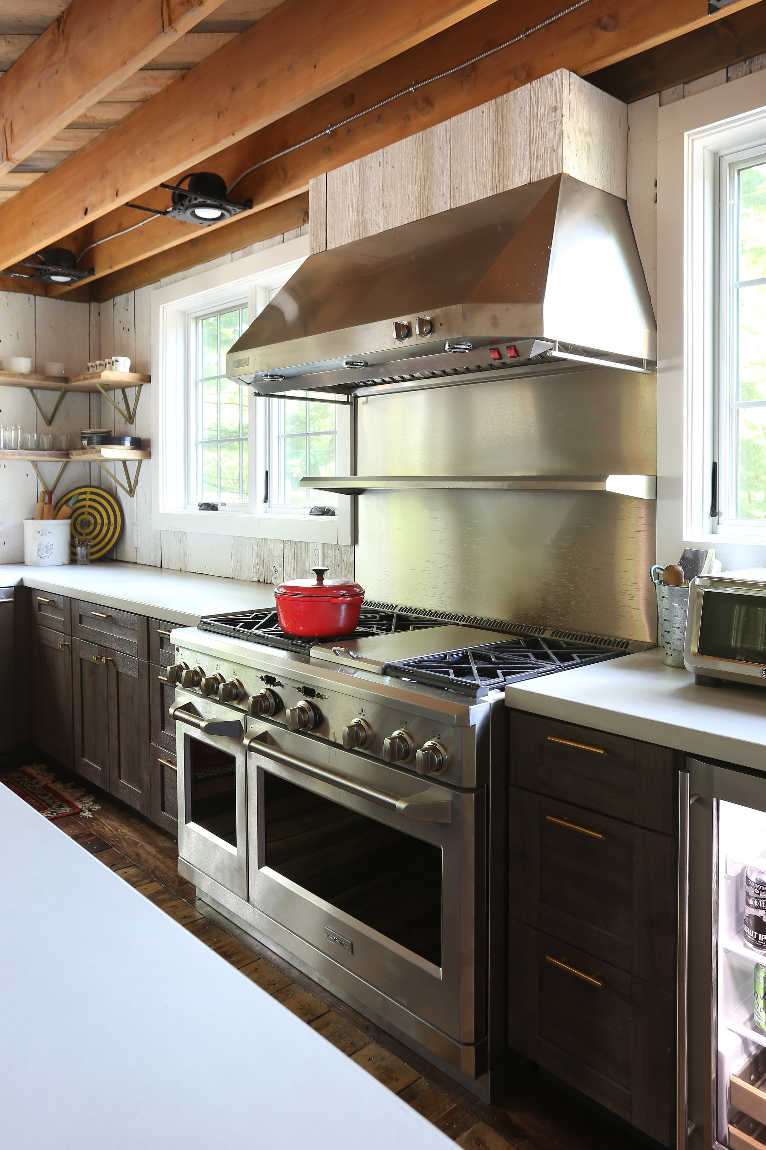 """Monogram 48"""" Stove - We are big fans of entertaining and have everything we need to host large gatherings. With the help of our 48"""" Monogram stove equipped with a top shelf heat lamp and double oven feature, we can keep everything warm and tasting fresh."""