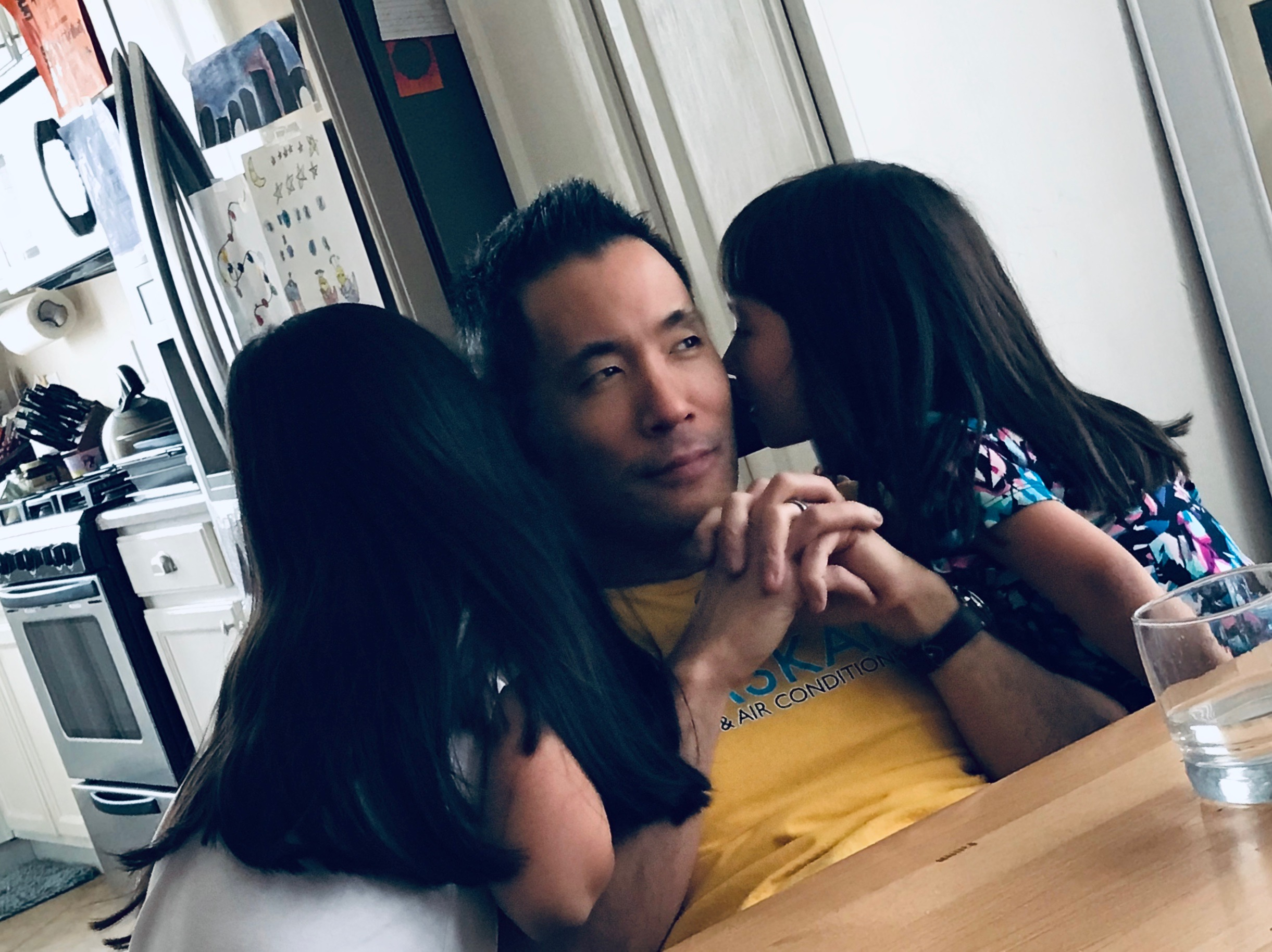 I love this picture of my husband and kids!  After dinner they tried to see if you could talk into daddy's ear on one side and hear it come out the other ear ;) Post family meal.
