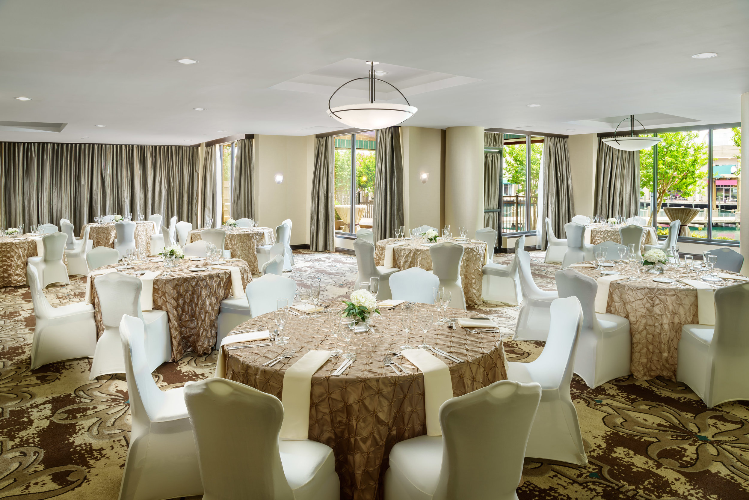 Reception Venue done with champagne and cream linens