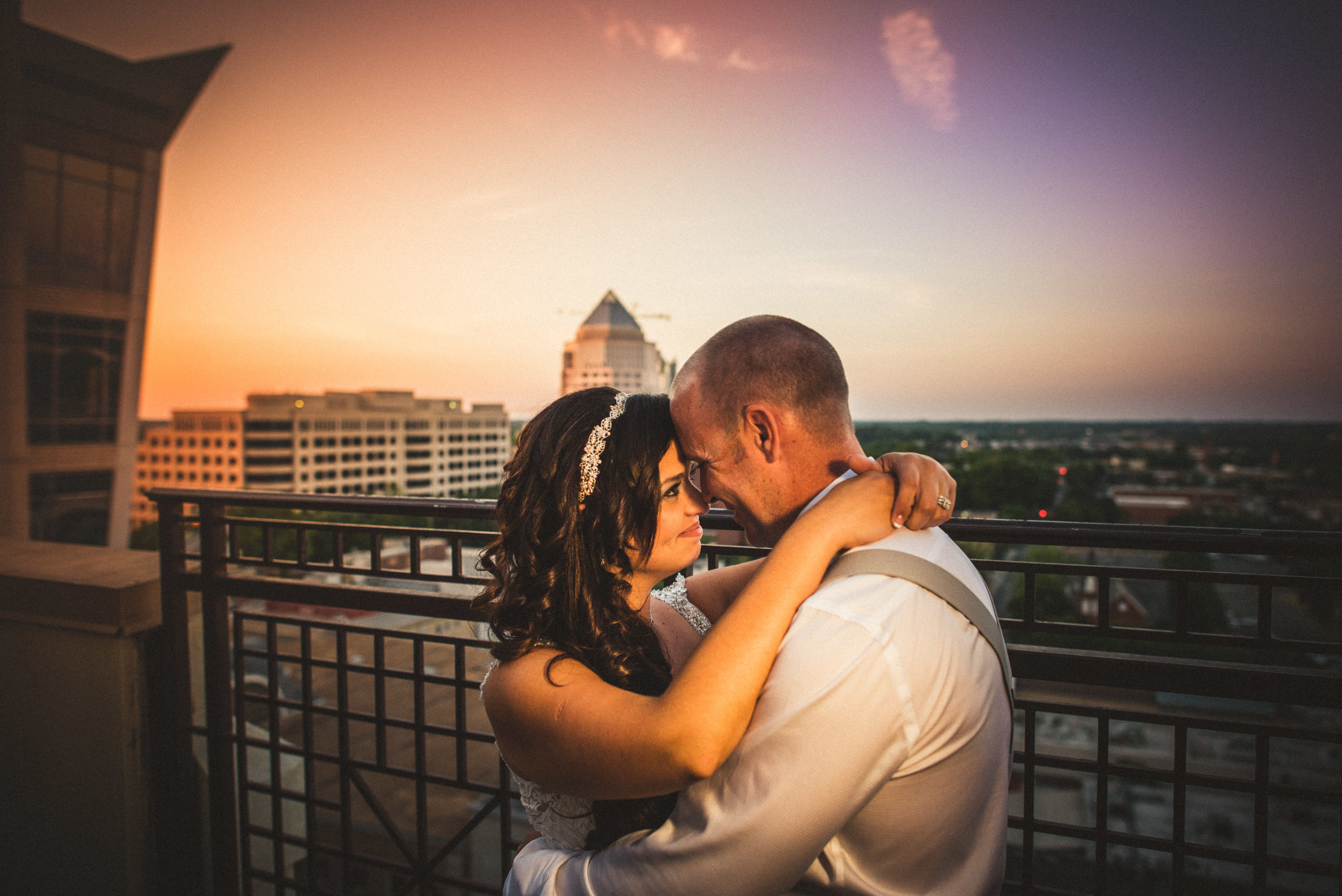 Bride and groom embrace with Odell bldg.jpg