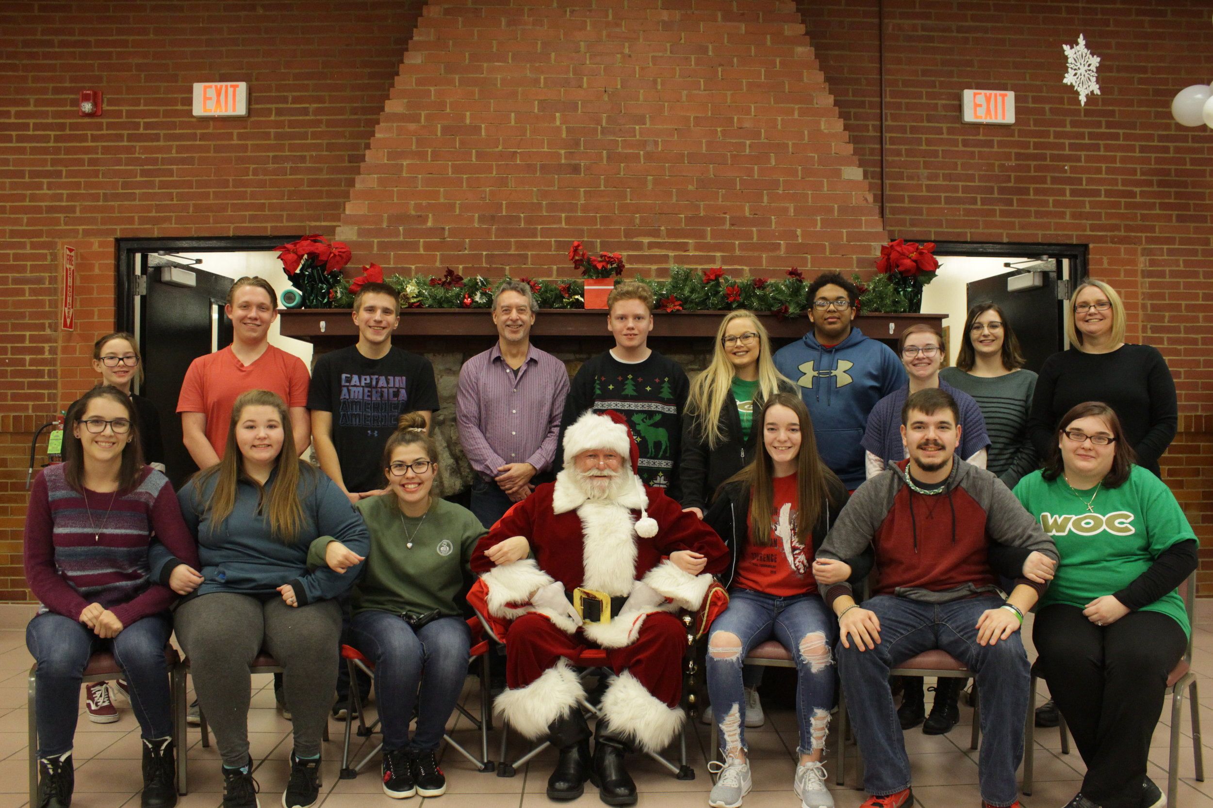 Volunteers come together for a picture after helping out during the 2018 annual Christmas party.