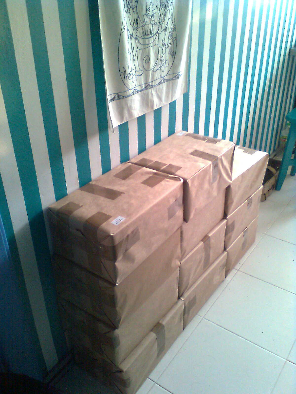 "Storing and shipping ""One Thousand Book Covers"" in a small apartment."