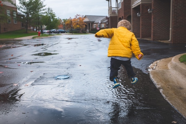 boy_jumping_in_puddles.jpg