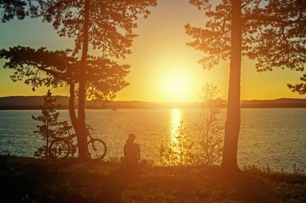 girl_sitting_by_lake_with_bike.jpg