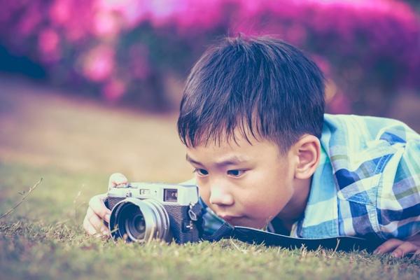 boy_taking_photo_in_nature.jpg