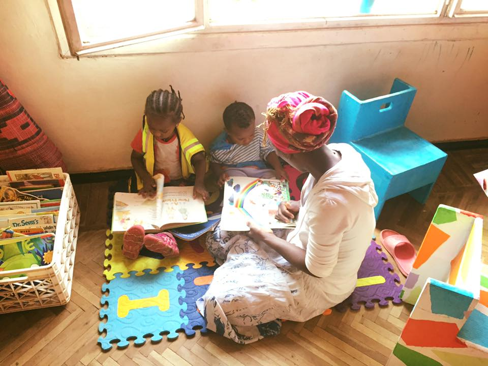 Eyerusalem shares a sweet moment looking through a book with her son Kirubel.
