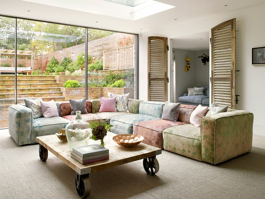 living-room-design-with-l-shaped-floral-sofa-and-small-wooden-coffee-table-on-wheels.jpg