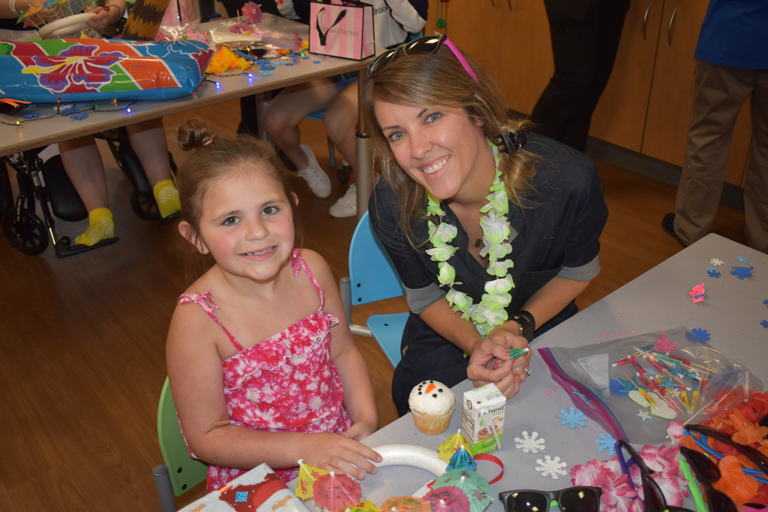 Leigh Ann O'Neill celebrates Christmas in July with patients at Peyton Manning Children's Hospital as part of a new youth volunteer program.