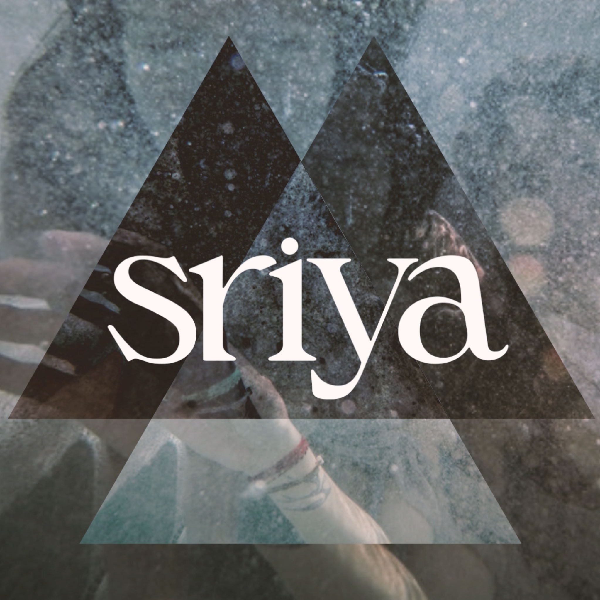 sriya - Is the spontaneously journey of two voices that become many. Formed with deep intention and devotion to song as a Universal language, and accessing timelines future and past, the flow takes singers SriMati and Riya on a unique adventure where voices begin in individuality, harmoniously answering the call, traveling into the unknown where in a field of sound they become one interchangeably. As the many voices create a sound bath of cellular nourishment where the tones communicate with the Self and nature throughout the multi-verse, the listener has the invitation to sing along and add their tones to this offering. Or simply melt into the field and allow the frequency to heal and transform you in her embrace. This sound healing experience is 21 minutes. It can be utilized in solo or group settings, yoga classes, meditations and relaxation. Please listen with headphones or great speakers to get the full effect.