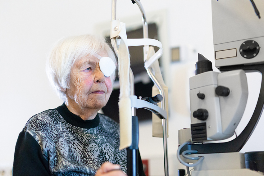 Lady with eye patch post cataract surgery visiting Ophthalmologist Brisbane.