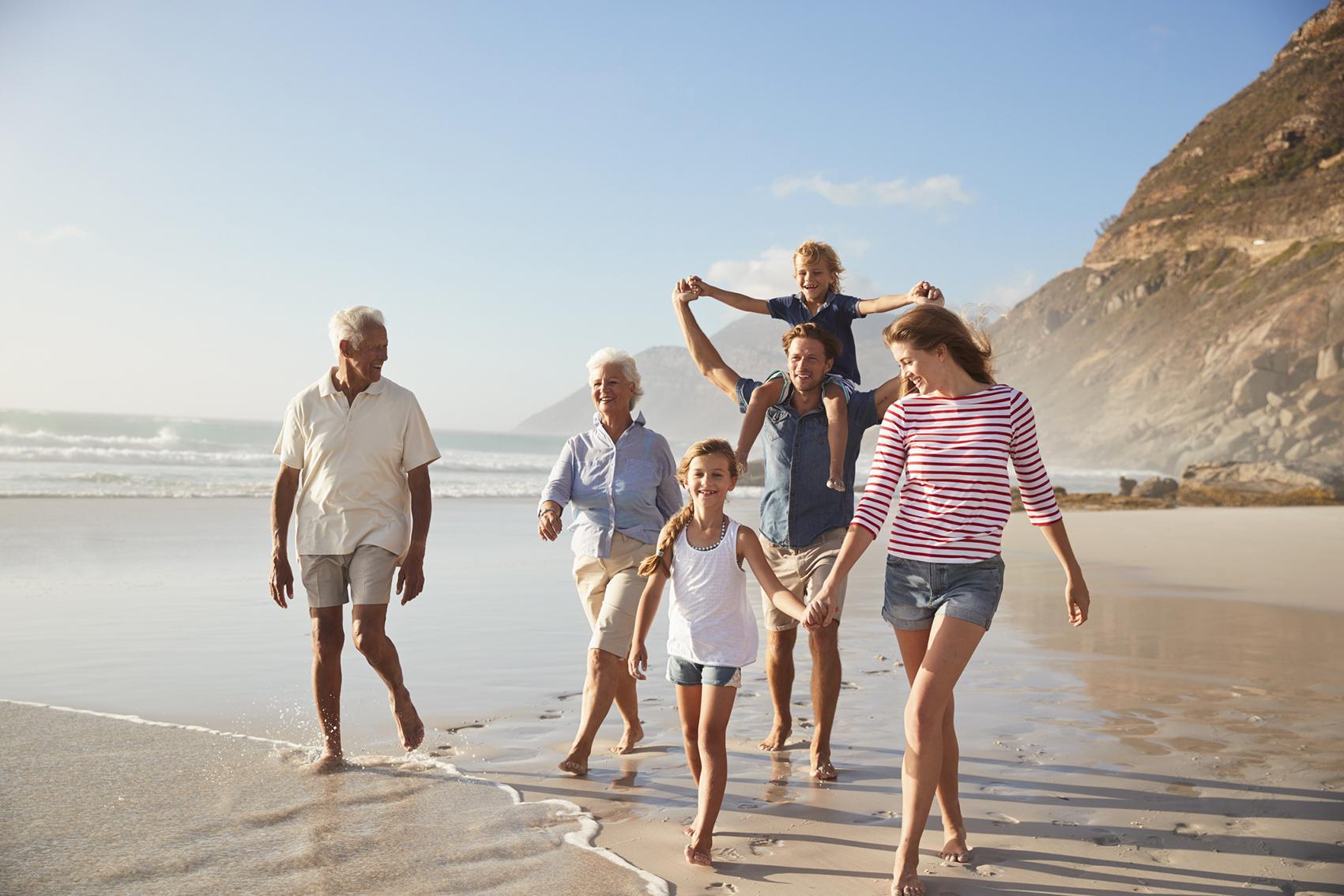 Family walking along the beach Brisbane.