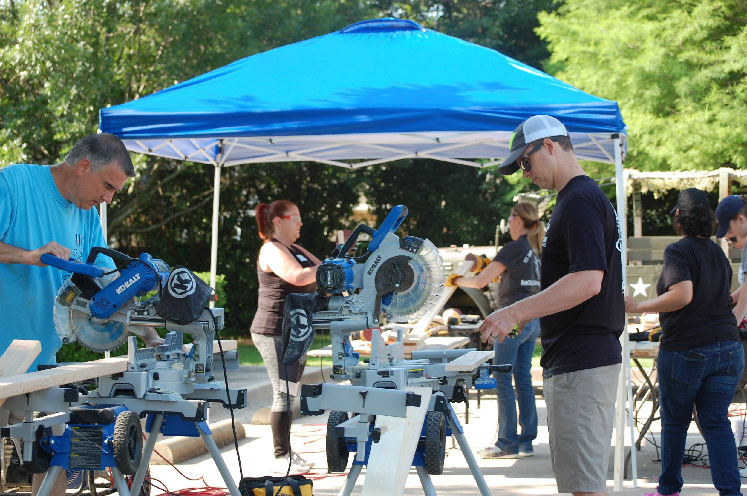GiveBack - Bunk Bed Build Day - Working 1.JPG