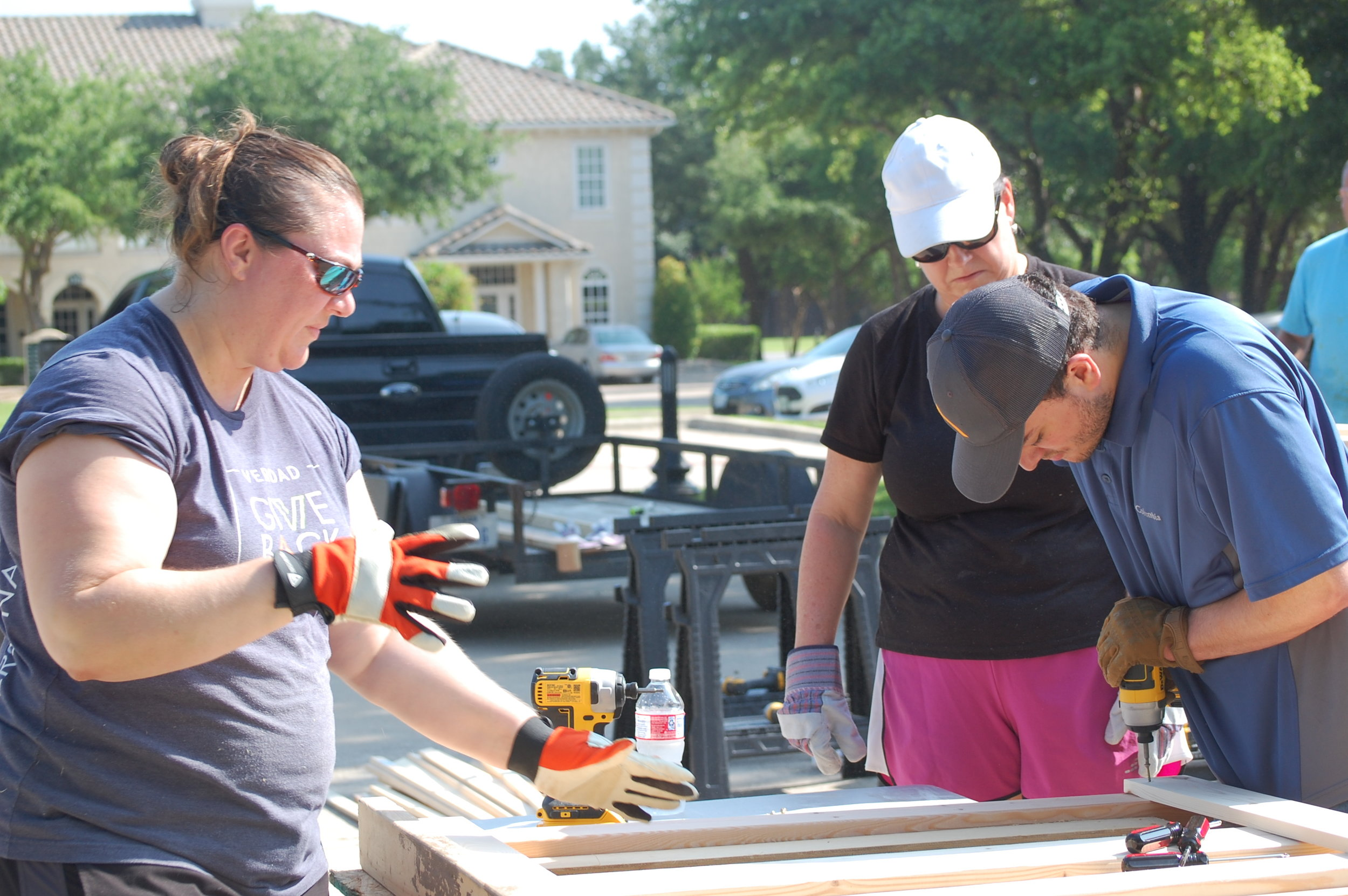 GiveBack - Bunk Bed Build Day - Working 3.JPG