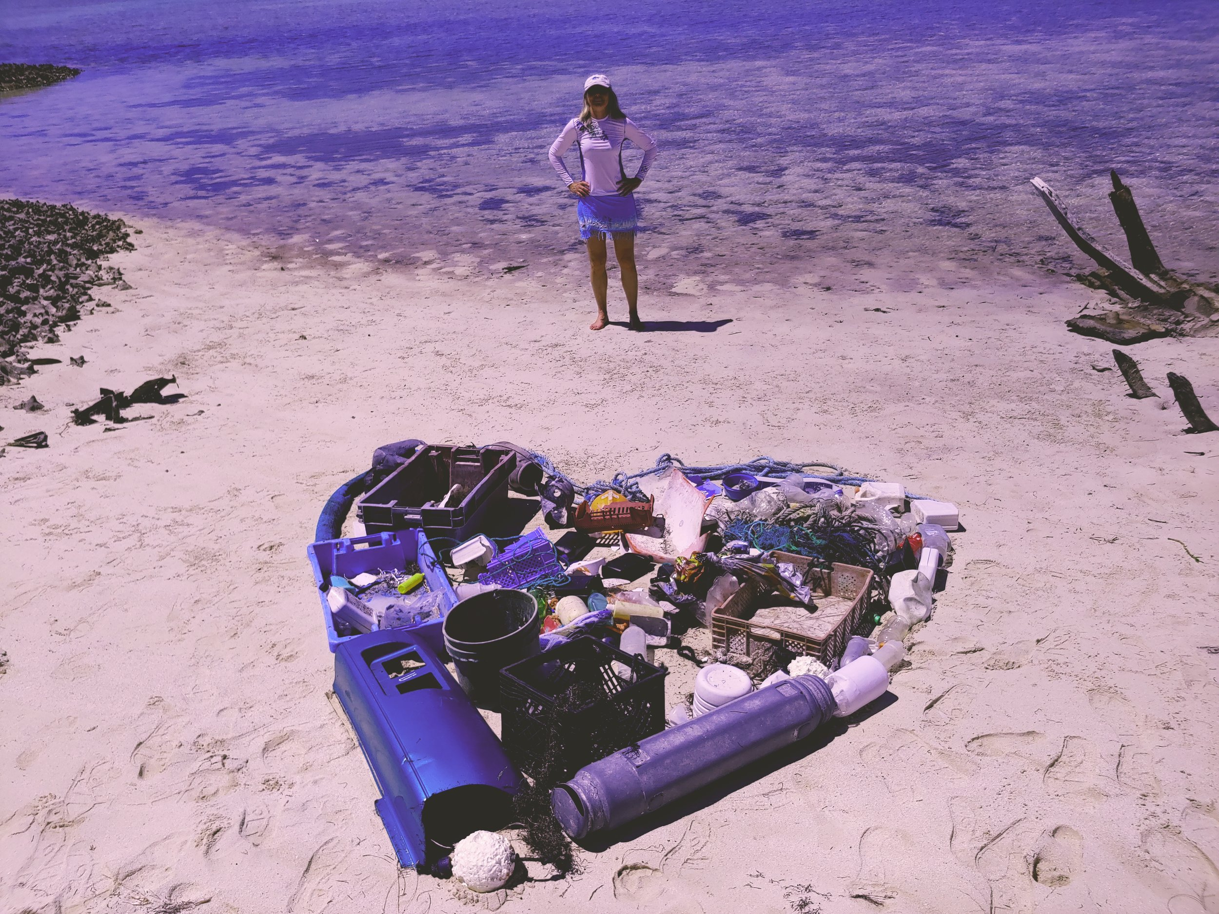 An hour of cleanup on Strangers Cay - Can you see the Toyota bumper?