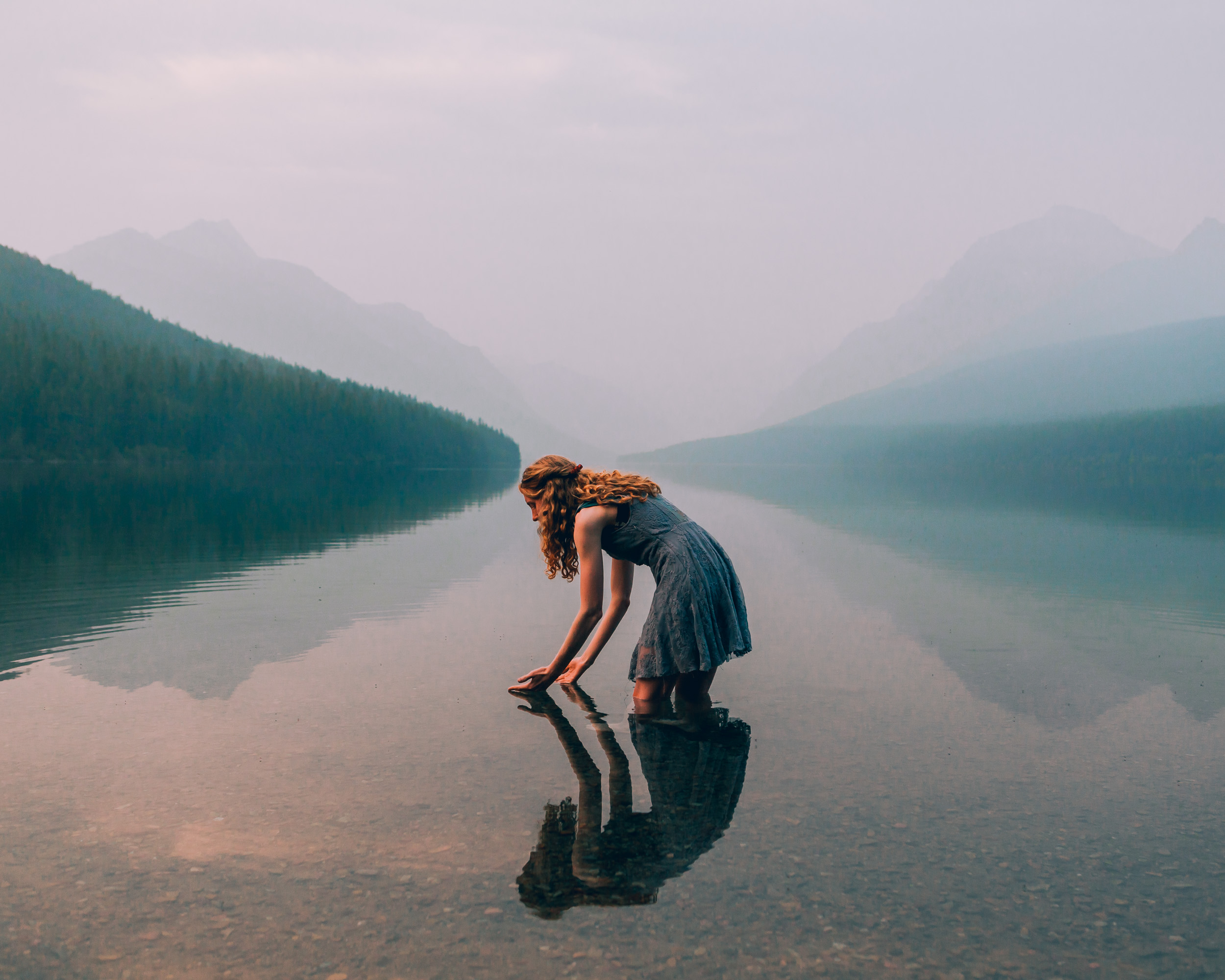 girl-reflection-bowman-lake-glacier-montana.JPG