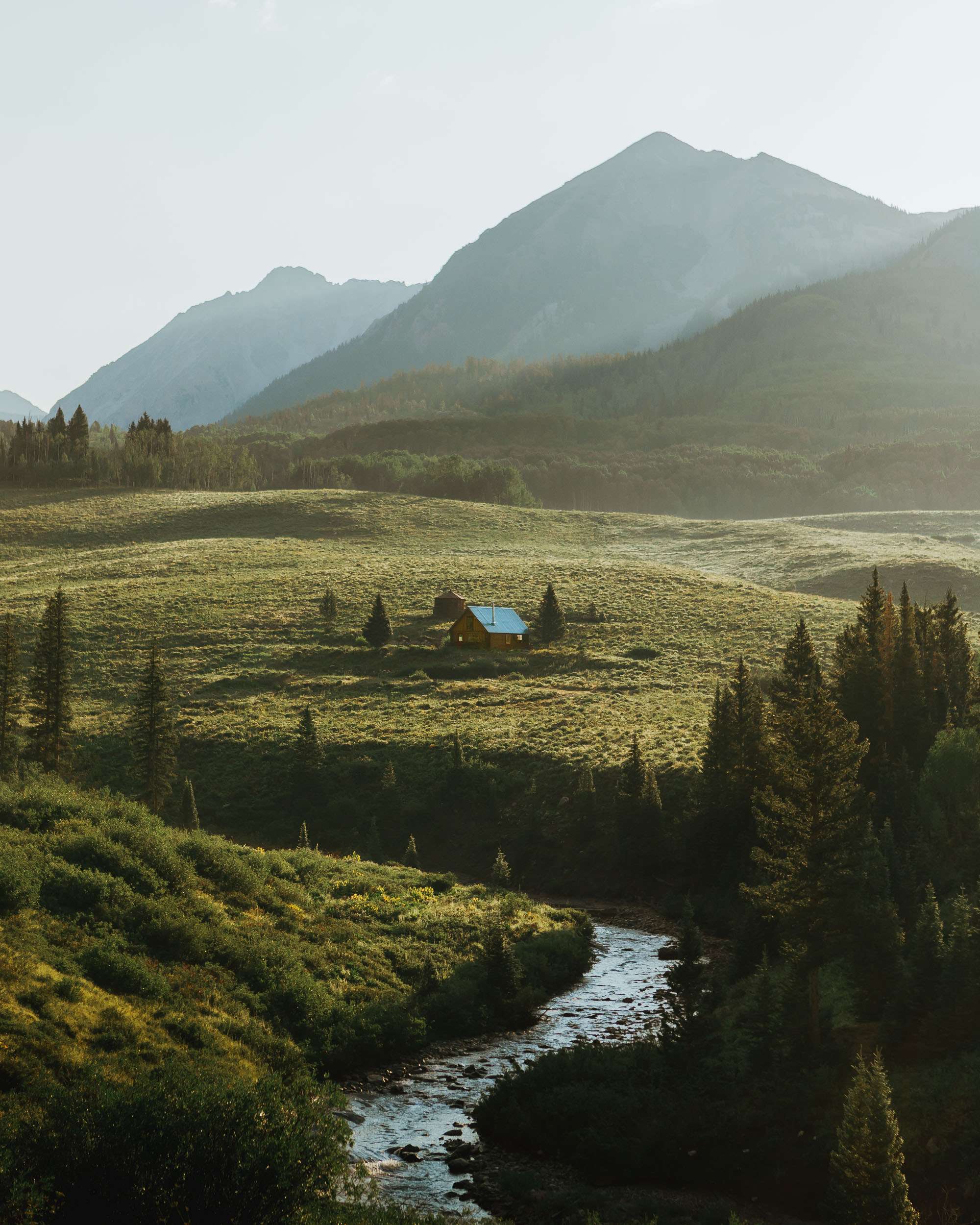 crested-butte-cabin-winding-river-mountains.JPG
