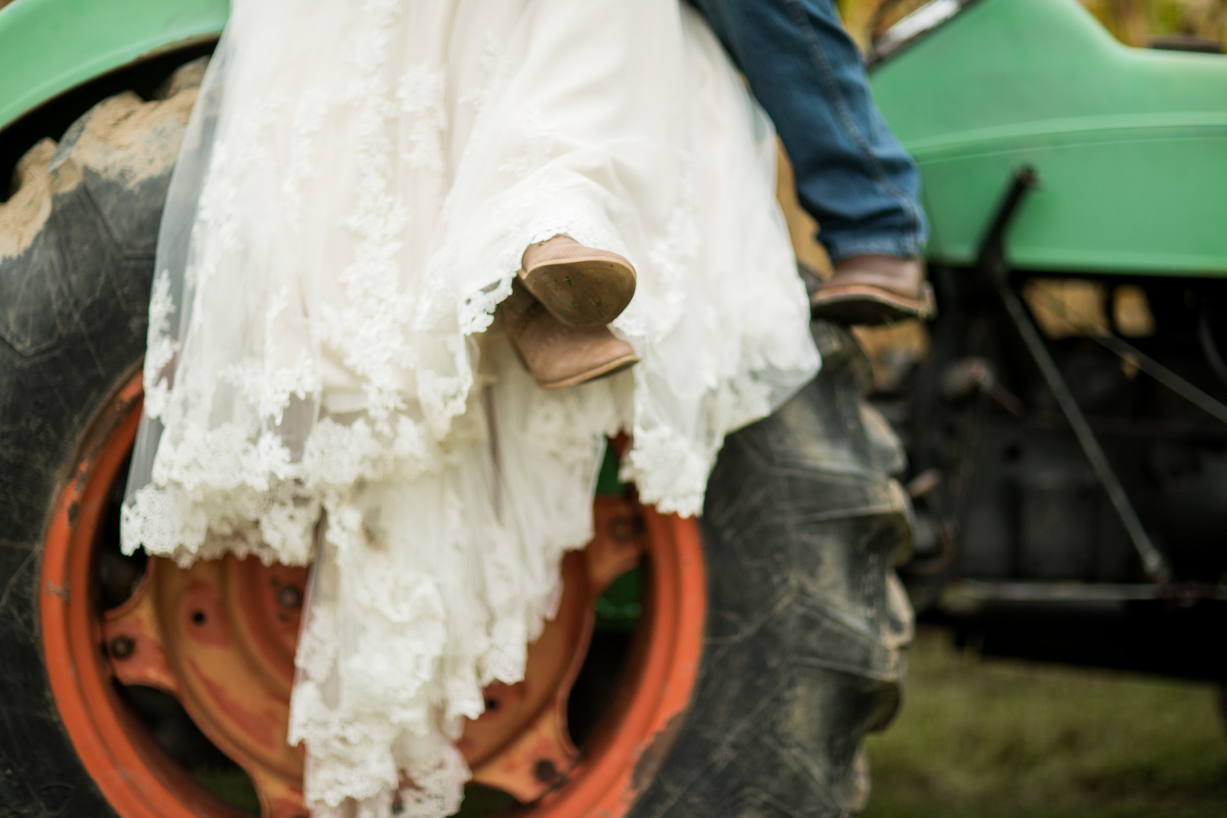 Bride and Groom on Tractor at Rustic Barn Wedding Venue