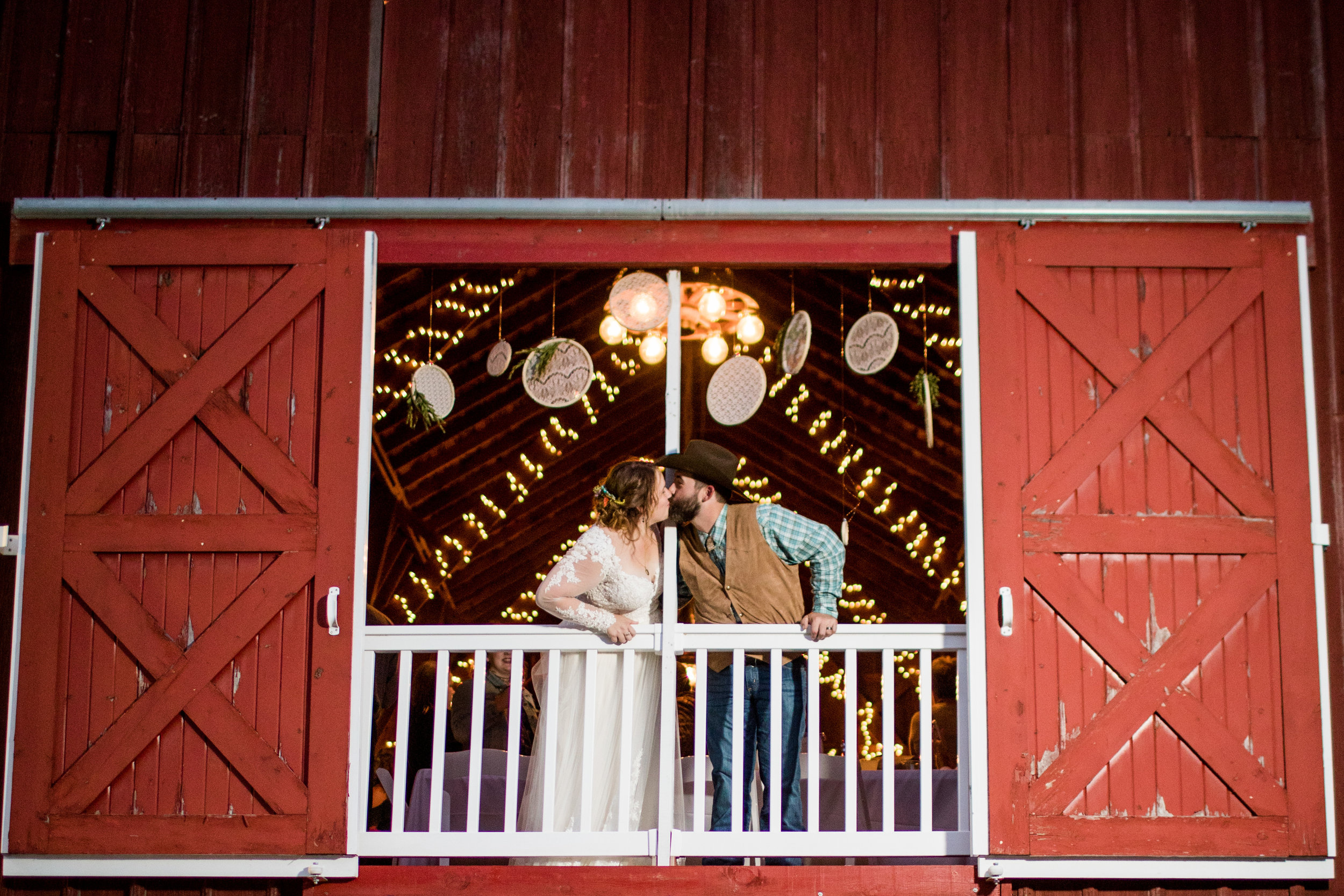 Bride and Groom in Barn Window