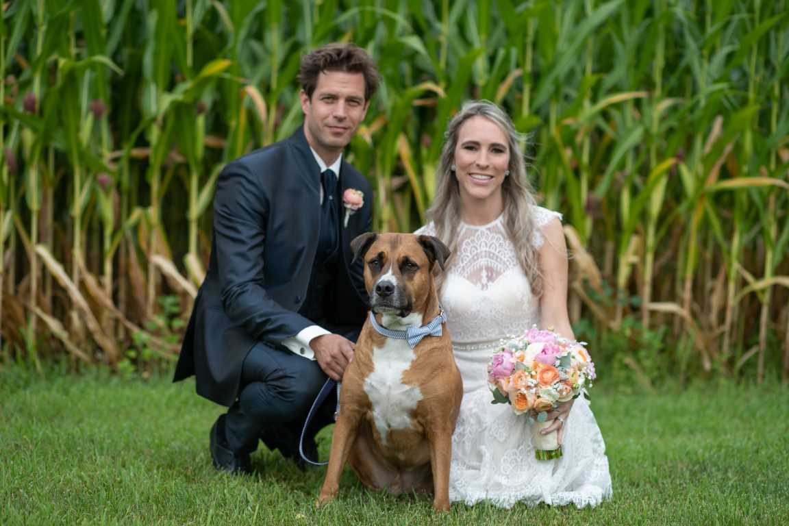 Happy couple poses with dog