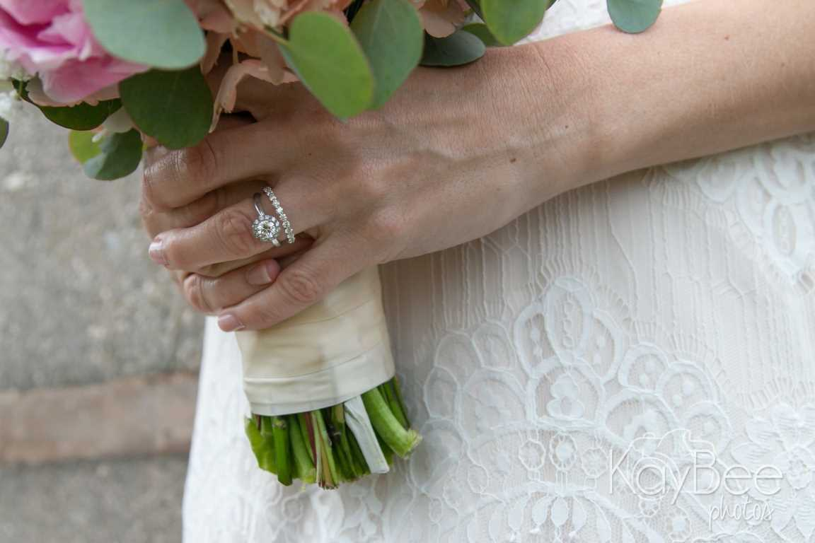 Ceremony details - bride with bouquet and ring