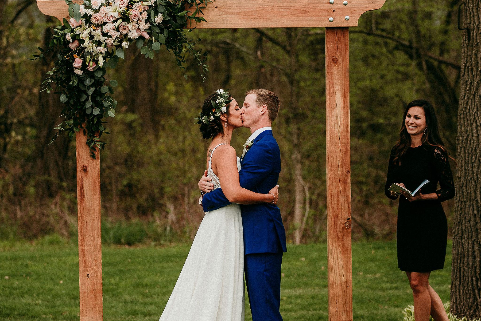 Couples Kisses After Vows