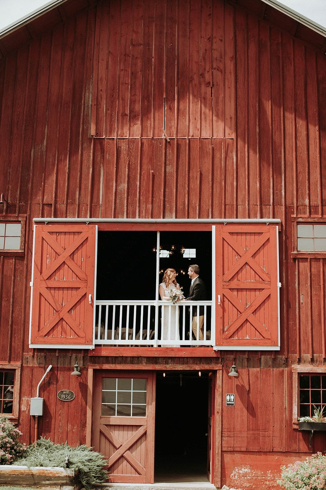 bride-and-groom-at-popular-photo-spot-back-acres-barn-min.jpg