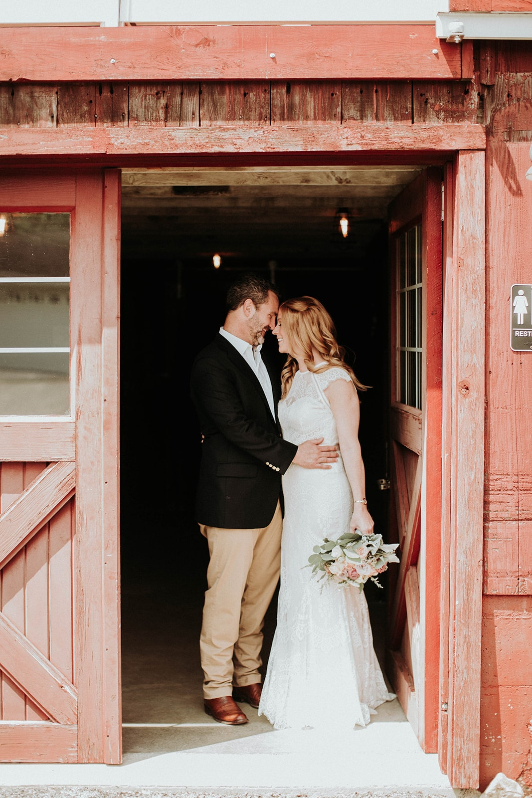 bride-and-groom-framed-in-barn-doorway-min.jpg