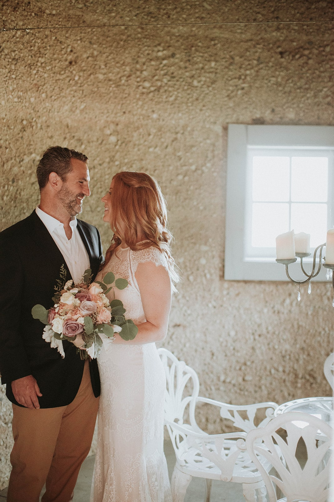bride-and-groom-share-moment-in-barn-silo-min.jpg