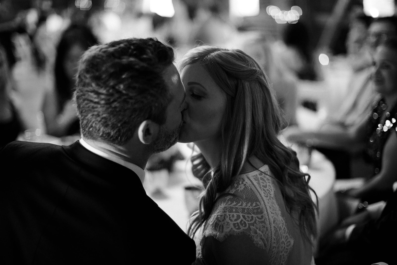 couple-kisses-at-reception-min.jpg