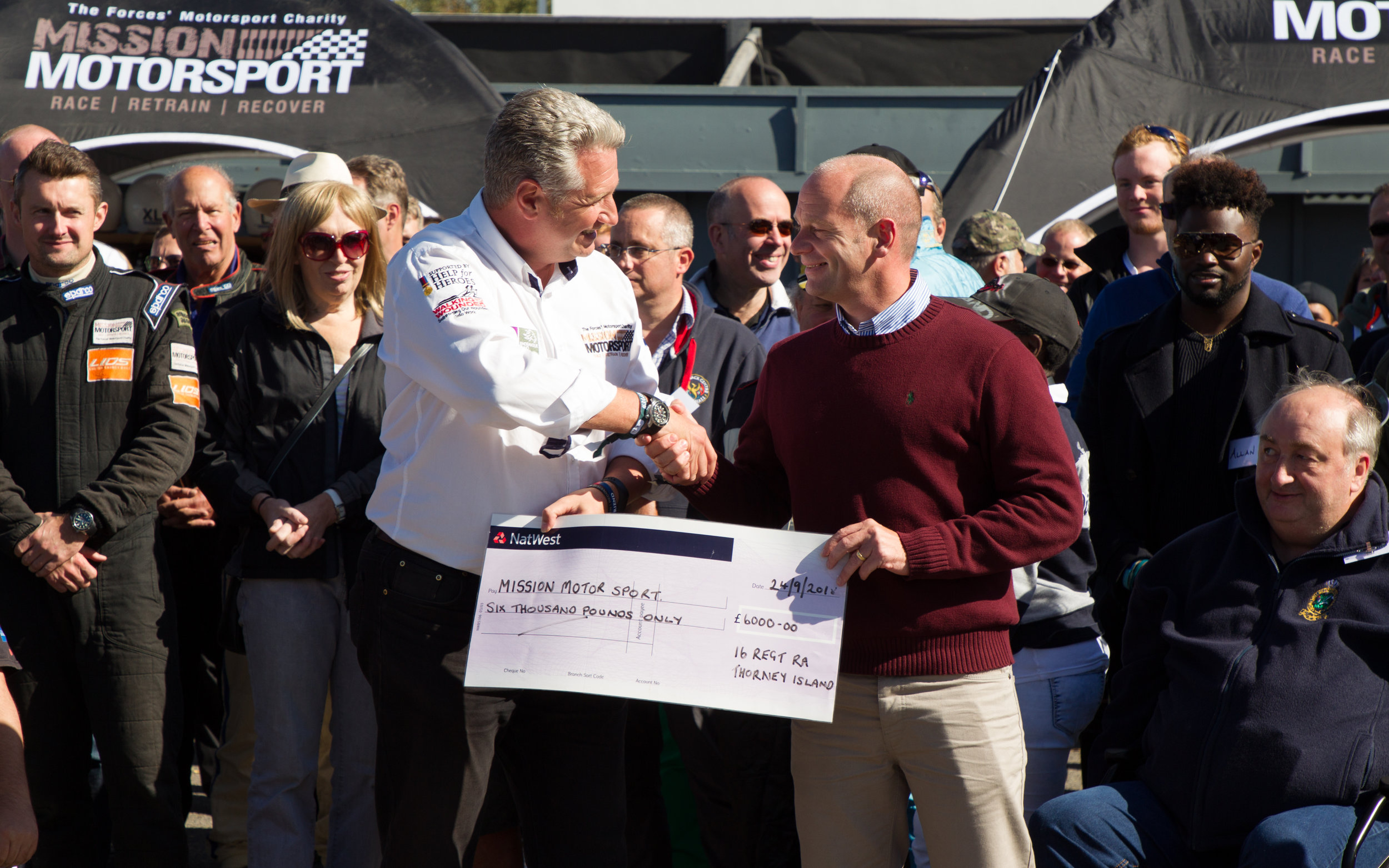 16 Regt Royal Artillery donating a cheque after a boxing night to raise money for Mission Motorsport