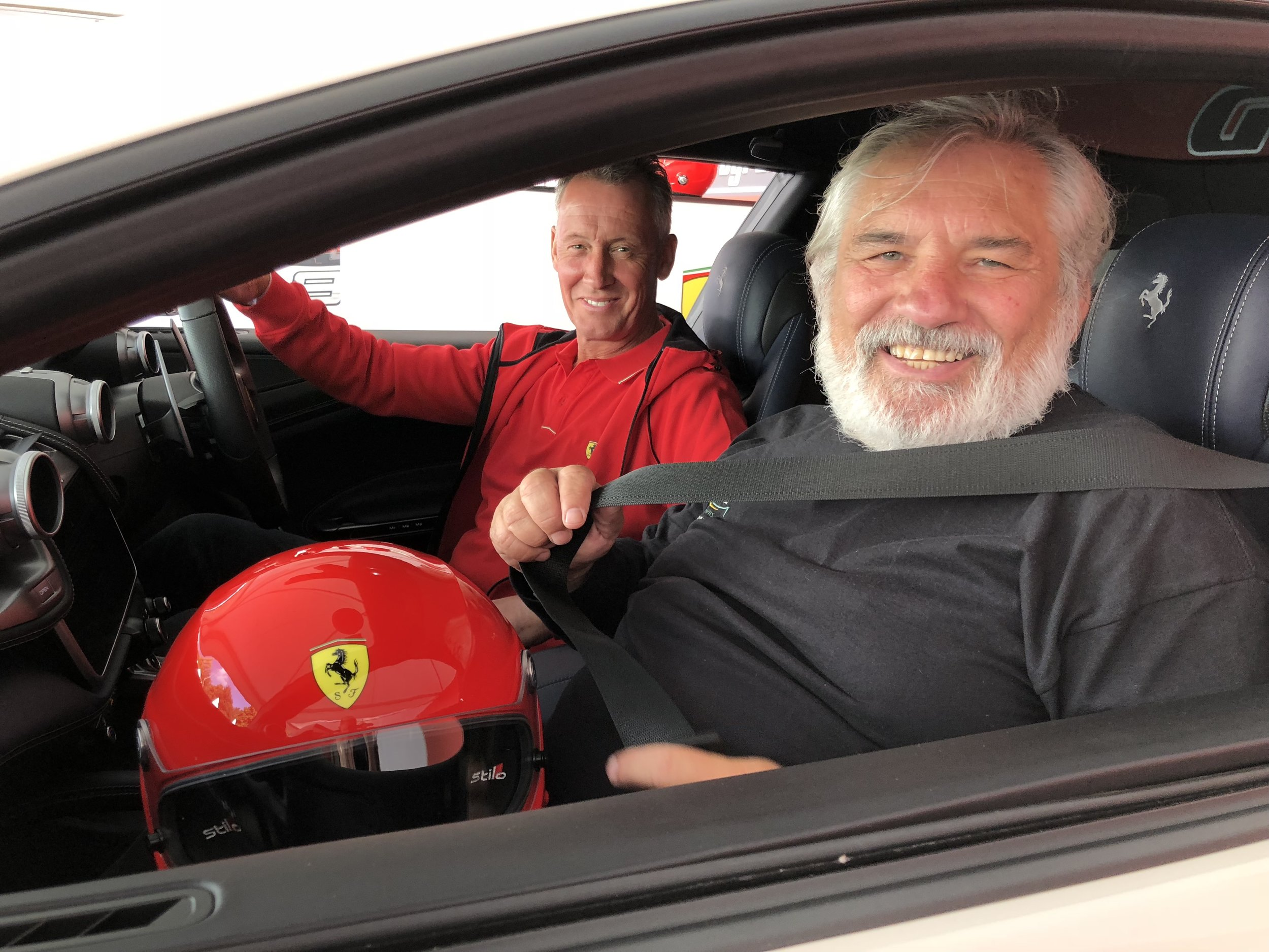 MM Beneficiary Kevin Reilly beaming after a passenger ride in a Ferrari