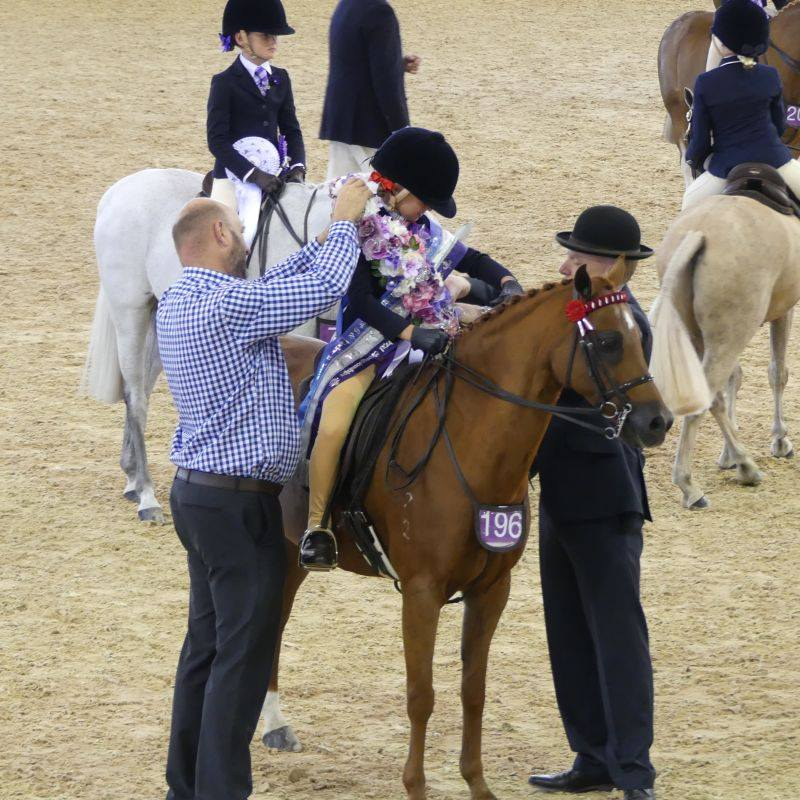 Charli being awarded Champion Rider 6 Years and Under 9 Years