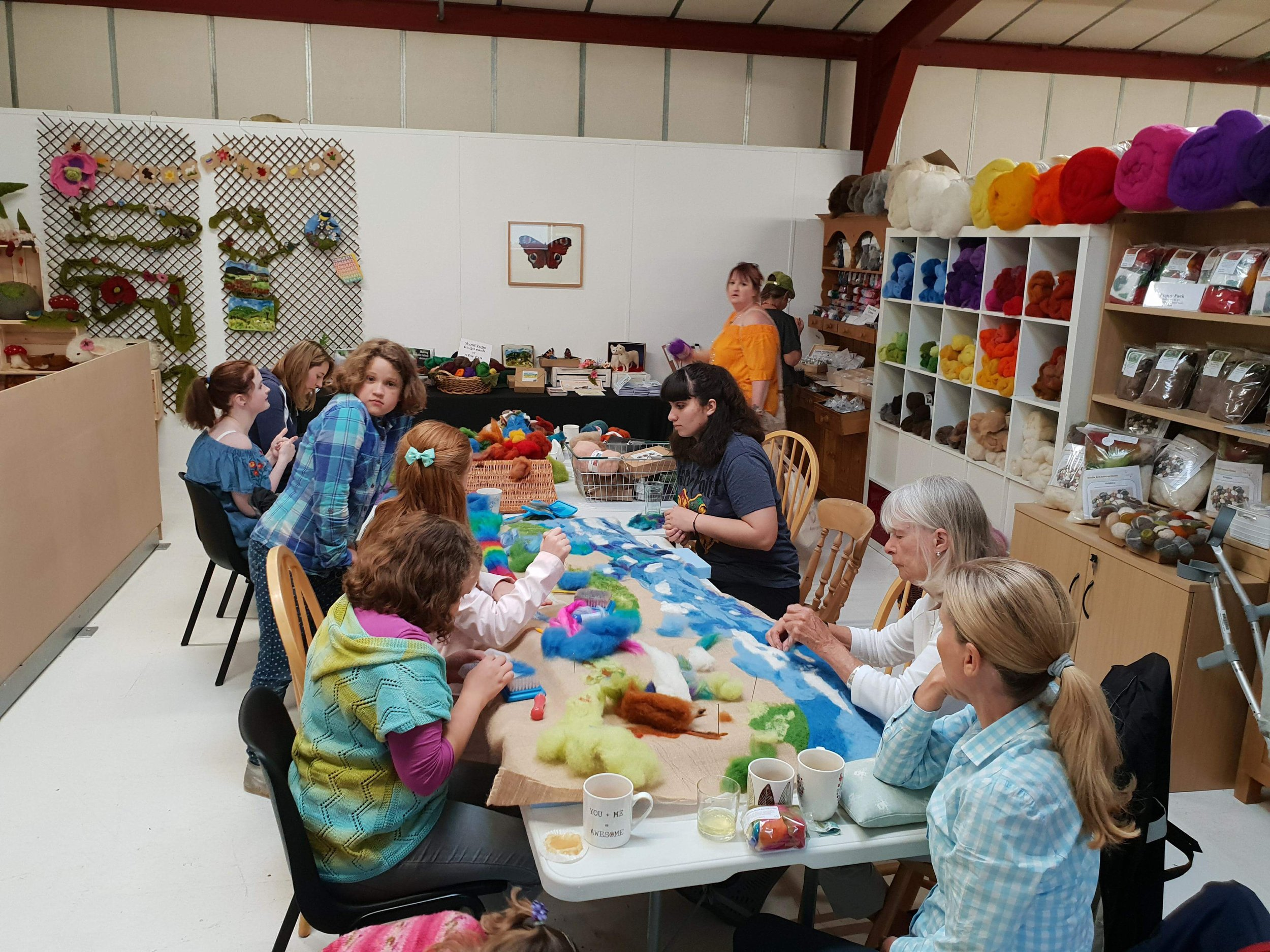 A group needle felting a picture together at our shop opening 31st May 2018.jpg