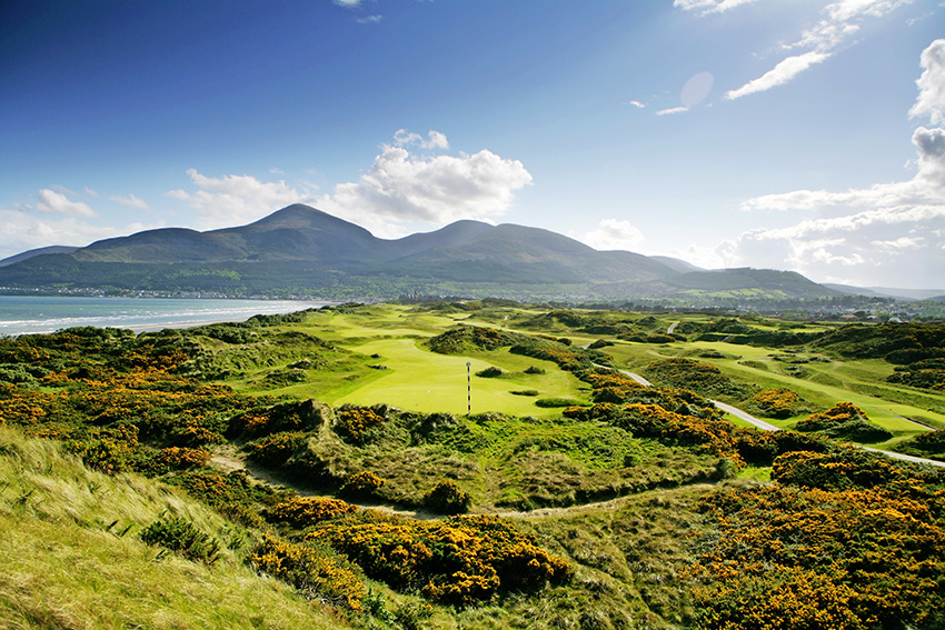 The marker post is often required on the majestic 3rd green at Royal County Down, while the par-4 3rd is to the right.