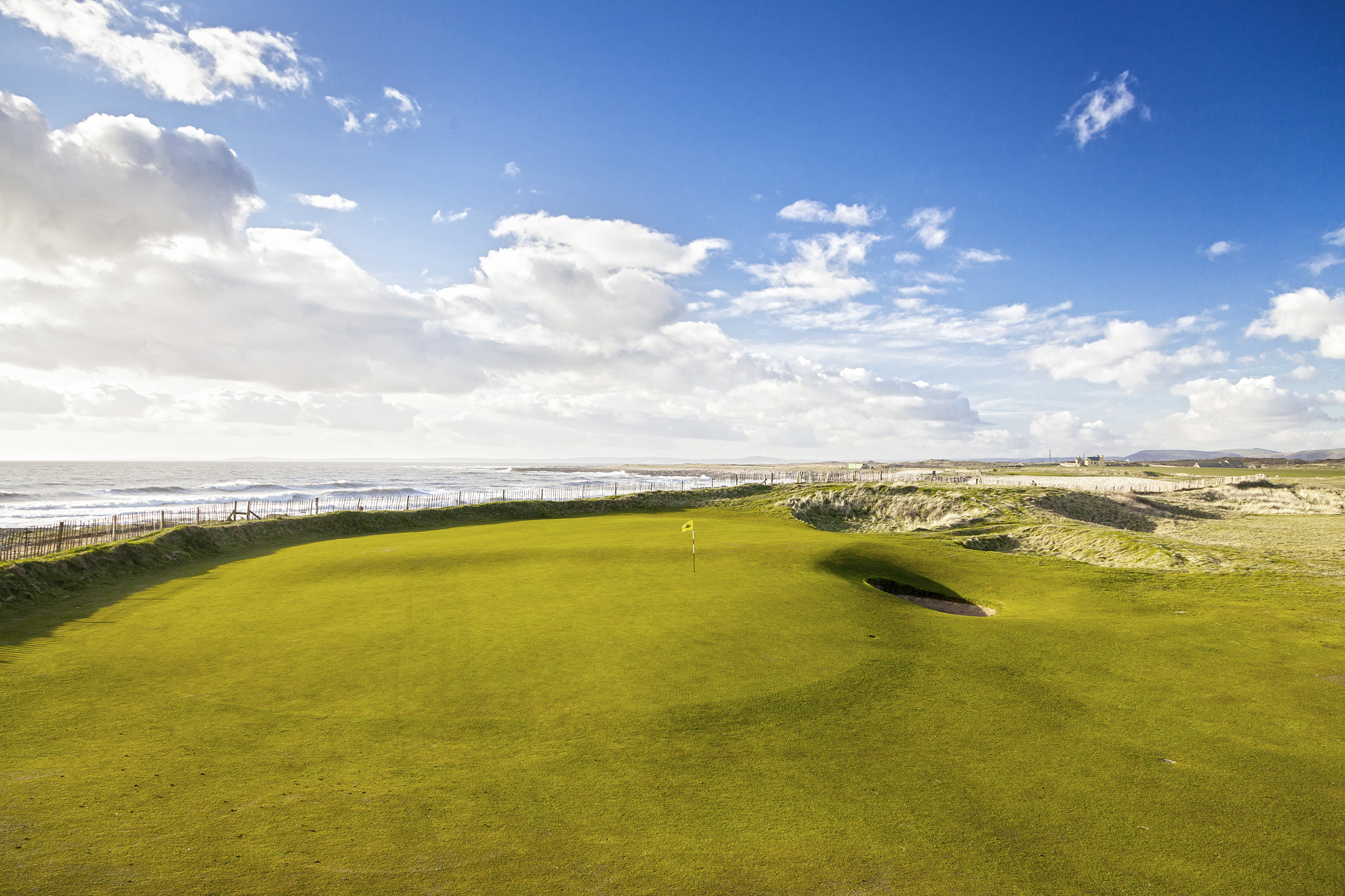 An illustration of the beautiful location enjoyed by the 2nd green at Royal Porthcawl.