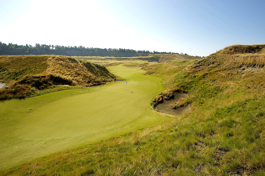 Steeply pitched dunes guard the entrance to the 10th green at Chambers Bay.