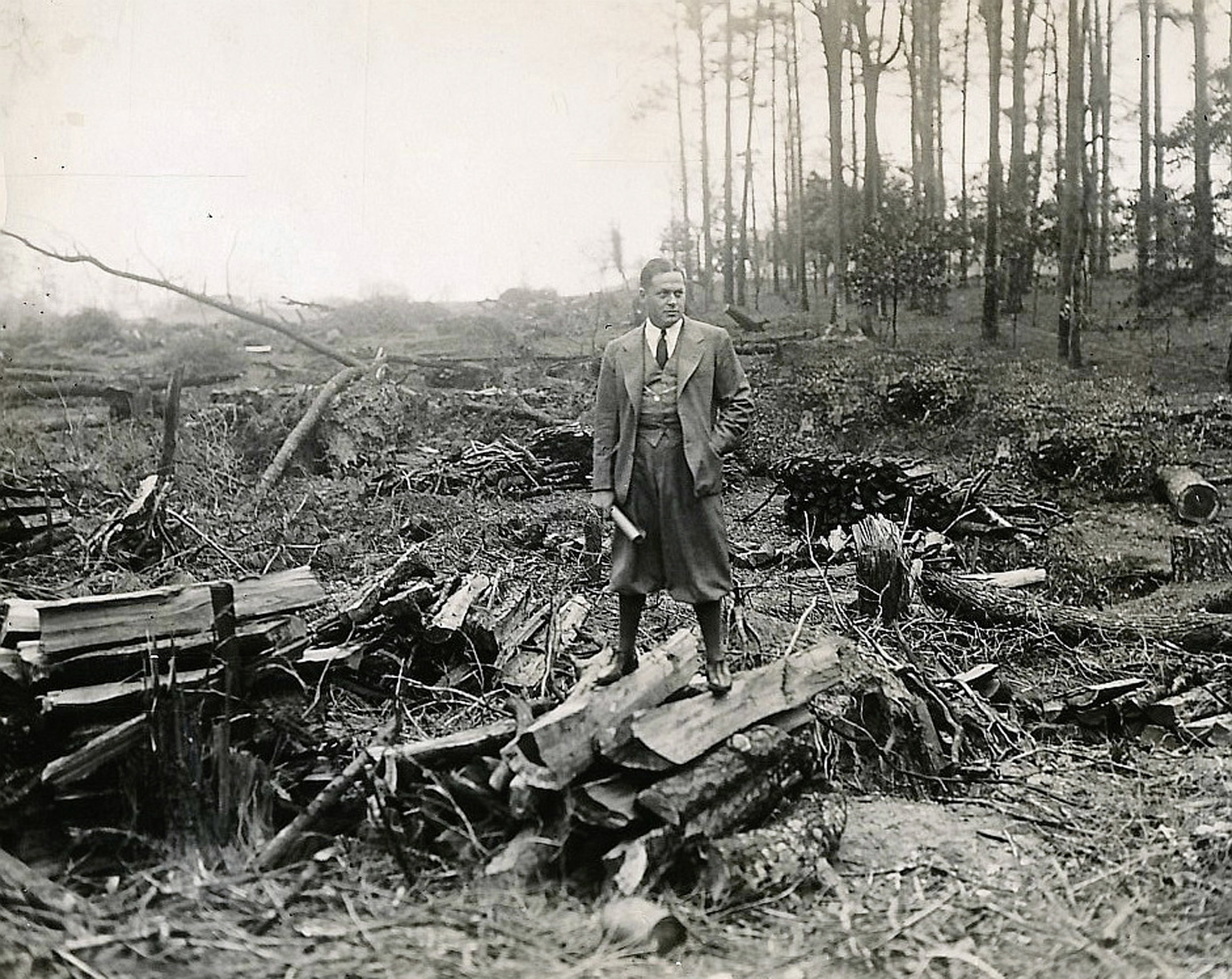 Bobby Jones surveys the Georgie fruit plantation that one day would become Augusta National Golf Club.
