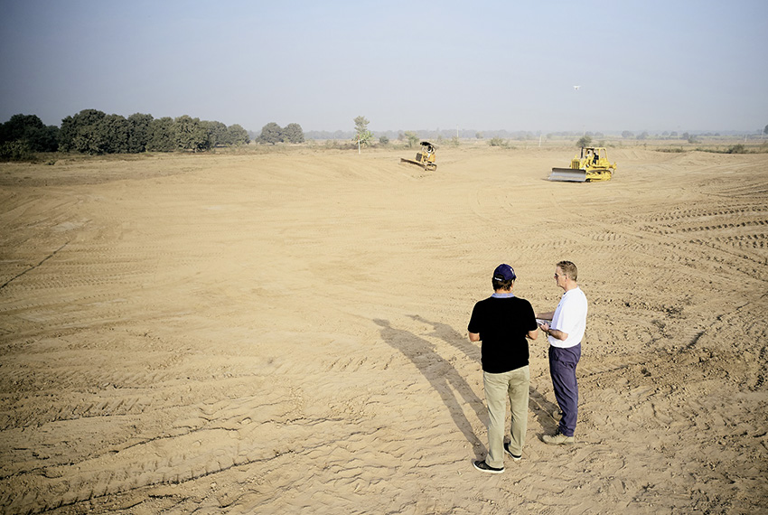 Sir Nick Faldo and Faldo Design's Andrew Haggar survey the Rumanza Golf Course site (lr).jpg