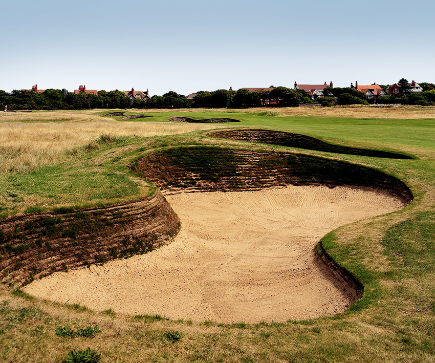 BEFORE: At the 2006 Open, the revetting extended to the entire height of the bunker face, creating an excessively harsh and stark look.