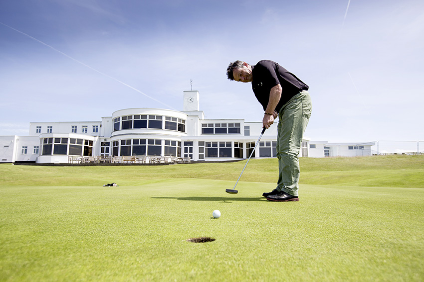 Our author holes out on the 18th at Royal Birkdale in front of the iconic white clubhouse.