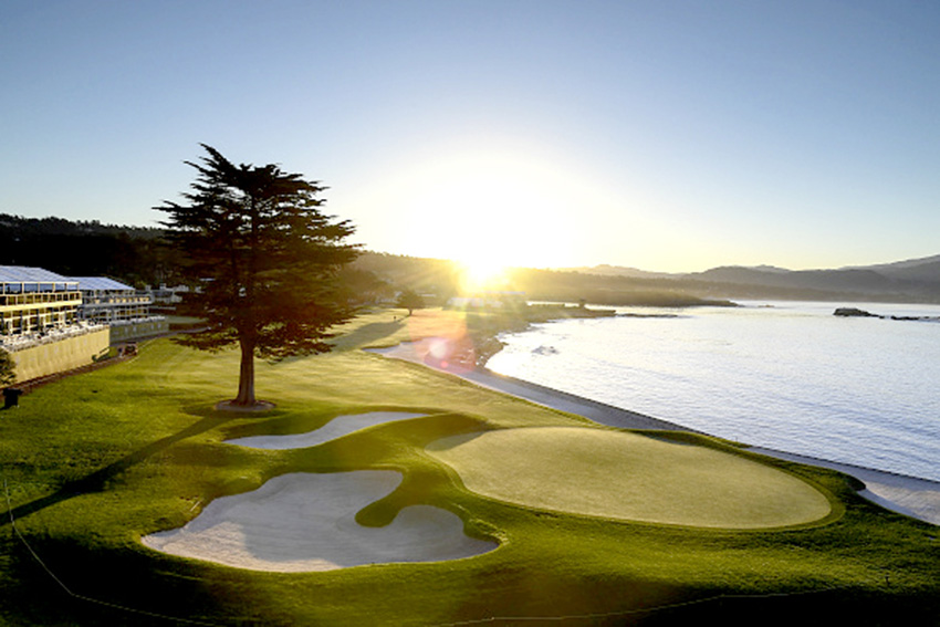 A happy ending: the sun sets over Pebble Beach and its closing hole.